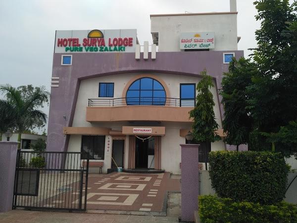 Hotel Surya Pureveg and Lodge, Zalki's Logo